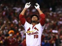 St. Louis Cardinals pinch hitter Oscar Taveras (18) celebrates after hitting a solo home run against the San Francisco Giants during the 7th inning in game two of the 2014 NLCS playoff baseball game at Busch Stadium on October 12, 2014. Jasen Vinlove-USA TODAY Sports