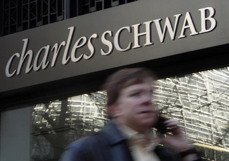A man walks past a Charles Schwab Investment branch in Washington January 19, 2010.  REUTERS/Jim Young