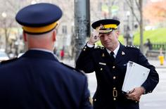 Royal Canadian Mounted Police Commissioner Bob Paulson (R) prepares to testify before a Senate committee in Ottawa October 27, 2014.   REUTERS/Blair Gable