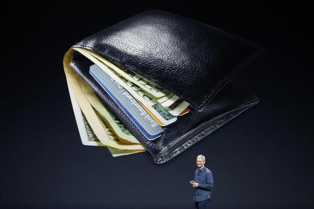 Apple CEO Tim Cook speaks about Apple Pay during an Apple event at the Flint Center in Cupertino, California, September 9, 2014. REUTERS/Stephen Lam