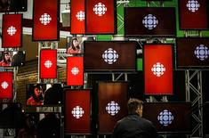 A man sits inside the Canadian Broadcast Corporation (CBC) broadcasting centre in Toronto May 23, 2014. REUTERS/Mark Blinch
