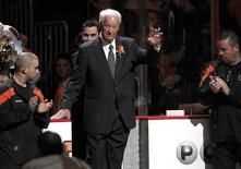 NHL Hall of Fame legend Gordie Howe waves as he enters the rink for a ceremony honoring his son, Philadelphia Flyers' NHL Hall of Fame defenseman, Mark before the start of the Flyers versus the Detroit Red Wings NHL ice hockey game in Philadelphia, Pennsylvania March 6, 2012. REUTERS/Tim Shaffer