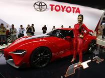 A model poses next to a Toyota FT-1 concept car during the International Sao Paulo Motor Show media day in Sao Paulo October 28, 2014. REUTERS/Paulo Whitaker