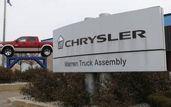A Chrysler sign is seen outside the Warren Truck Assembly plant where the Dodge Ram pickup truck is assembled in Warren, Michigan December 11, 2013.  REUTERS/Rebecca Cook