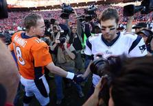 Jan 19, 2014; Denver, CO, USA; Denver Broncos quarterback Peyton Manning (18) and New England Patriots quarterback Tom Brady (12) shake hands after the 2013 AFC championship playoff football game at Sports Authority Field at Mile High. Mandatory Credit: Matthew Emmons-USA TODAY Sports