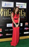 Bollywood actress Kalki Koechlin poses as she arrives on the green carpet for the International Indian Film Academy (IIFA) Awards show in Singapore June 9, 2012. REUTERS/Tim Chong/Files