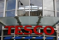 A Tesco sign is seen outside a store in south London October 23, 2014.  REUTERS/Stefan Wermuth