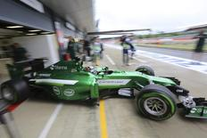 Caterham Formula One driver Kamui Kobayashi of Japan drives out from the pits during final practice ahead of the British Grand Prix at the Silverstone Race Circuit, central England, July 5, 2014. REUTERS/Paul Hackett