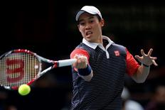 Kei Nishikori of Japan returns a shot during his men's singles quarter-final tennis match against David Ferrer of Spain at the Paris Masters tennis tournament at the Bercy sports hall in Paris, October 31, 2014. REUTERS/Benoit Tessier