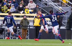 Nov 1, 2014; Columbus, OH, USA; New England Revolution defender/midfielder Chris Tierney (8) celebrates his goal in the second half of the game at Crew Stadium. New England Revolution beat the Columbus Crew by the score of 4-2. Mandatory Credit: Trevor Ruszkowski-USA TODAY Sports