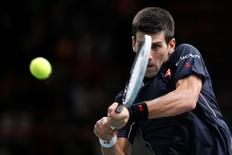 Novak Djokovic of Serbia returns a shot during his men's singles final tennis match against Milos Raonic of Canada at the Paris Masters tennis tournament at the Bercy sports hall in Paris, November 2, 2014. REUTERS/Benoit Tessier
