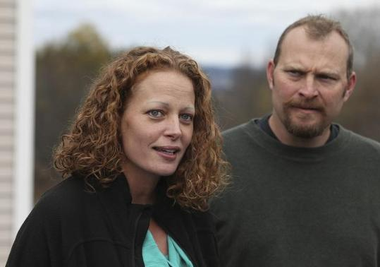 Nurse Kaci Hickox (L) joined by her boyfriend Ted Wilbur speak with the media outside of their home in Fort Kent, Maine October 31, 2014. REUTERS/Joel Page