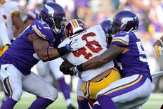 Nov 2, 2014; Minneapolis, MN, USA; Washington Redskins running back Alfred Morris (46) is tackled by Minnesota Vikings linebacker Jasper Brinkley (54) and defensive end Everson Griffen (97) during the third quarter at TCF Bank Stadium. The Vikings defeated the Redskins 29-26. Mandatory Credit: Brace Hemmelgarn-USA TODAY Sports