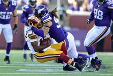 Nov 2, 2014; Minneapolis, MN, USA; Minnesota Vikings defensive end Brian Robison (96) sacks Washington Redskins quarterback Robert Griffin (10) during the third quarter at TCF Bank Stadium. The Vikings defeated the Redskins 29-26. Mandatory Credit: Brace Hemmelgarn-USA TODAY Sports
