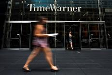 A woman walks past the Time Warner Center near Columbus Circle in Manhattan, New York in this file photo from July 16, 2014.  REUTERS/Adrees Latif/Files