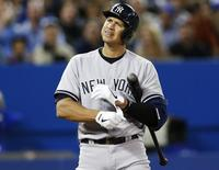 New York Yankees Alex Rodriguez reacts during an at bat against the Toronto Blue Jays during the fifth inning of their MLB American League baseball game in Toronto, September 17, 2013.  REUTERS/Mark Blinch