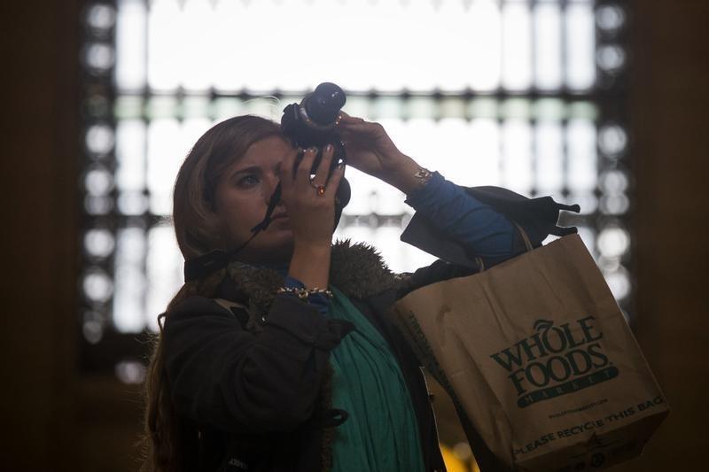 Whole Foods profit beats on market share gains