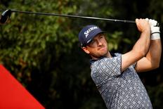 Graeme McDowell of Northern Ireland tees off on the ninth hole during the first round of the WGC-HSBC Champions golf tournament in Shanghai November 6, 2014. REUTERS/Aly Song