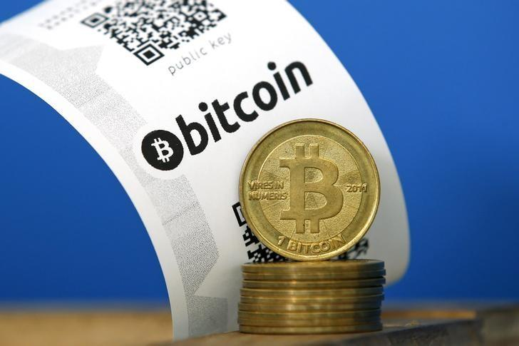 A Bitcoin (virtual currency) paper wallet with QR codes and coins in an illustration picture taken at La Maison du Bitcoin in Paris, July 11, 2014.   REUTERS/Benoit Tessier