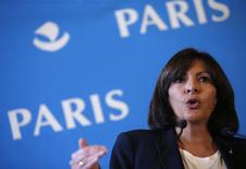 Mayor of Paris Anne Hidalgo speaks during a news conference at Paris city hall, November 7, 2014. REUTERS/Christian Hartmann