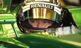 O piloto de F1 da Caterham, o japonês Kamui Kobayashi, durante treino para o Grande Prêmio da Inglaterra, no circuito de Silverstone, no centro da Inglaterra. 04/07/2014 REUTERS/Phil Noble