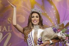 Isabella Santiago of Venezuela waves after she was crowned Miss International Queen 2014 at the transgender/transsexual beauty pageant in Pattaya November 7, 2014.  REUTERS/Athit Perawongmetha