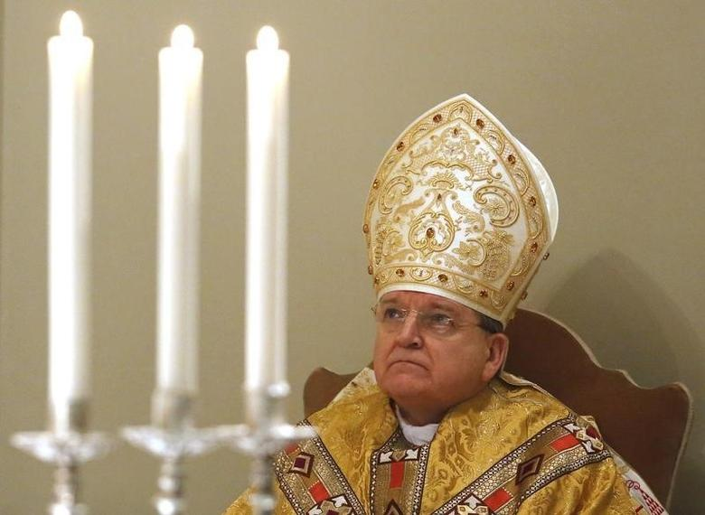 Cardinal Raymond Leo Burke leads a Holy Mass in the chapel of the Vatican Governorate to mark the opening of the Judicial Year of the Tribunal of Vatican City at the Vatican, January 11, 2014. REUTERS/Stefano Rellandini
