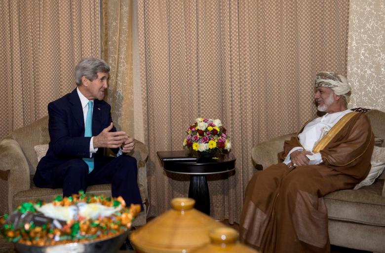U.S. Secretary of State John Kerry (L) meets with Omani Foreign Minister Yussef bin Alawi in Muscat November 9, 2014. REUTERS/Nicholas Kamm/Pool