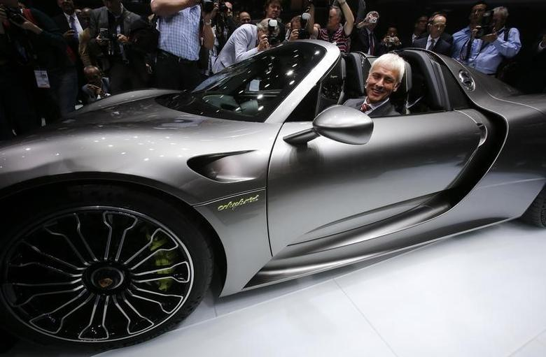 Porsche CEO, Matthias Mueller sits inside the new Porsche 918 Spyder hybrid car during a media preview day at the Frankfurt Motor Show (IAA) September 10, 2013. The world's biggest auto show will open to the public September 14-22.    REUTERS/Wolfgang Rattay