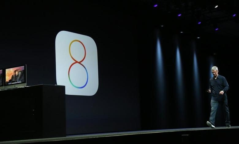 Apple CEO Tim Cook introduces the IOS 8 operating system during his keynote address at the Worldwide Developers Conference in San Francisco, California June 2, 2014. REUTERS/Robert Galbraith