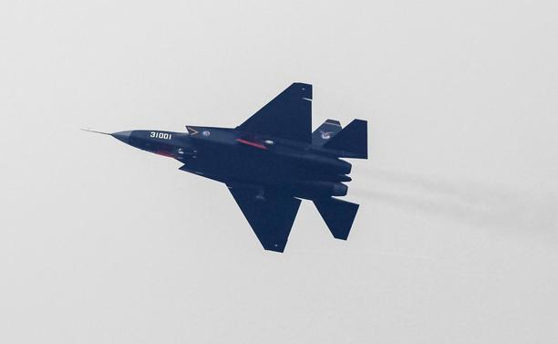 A J-31 stealth fighter of the Chinese People's Liberation Army Air Force is seen during a test flight ahead of the 10th China International Aviation and Aerospace Exhibition in Zhuhai, Guangdong province, November 10, 2014. REUTERS/Alex Lee