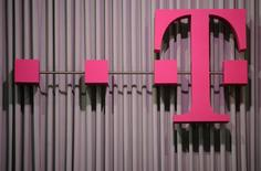 The logo of German company Deutsche Telekom is pictured at the CeBit computer fair in this file photo taken in Hanover, March, 6, 2012.  REUTERS/Fabian Bimmer
