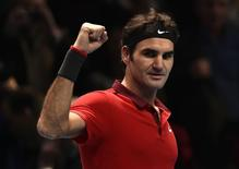 Roger Federer of Switzerland celebrates defeating Kei Nishikori of Japan in their tennis match at the ATP World Tour finals at the O2 Arena in London November 11, 2014. REUTERS/Toby Melville