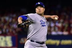 Oct 6, 2014; St. Louis, MO, USA; Los Angeles Dodgers starting pitcher Hyun-Jin Ryu (99) pitches during the first inning against the St. Louis Cardinals in game three of the 2014 NLDS baseball playoff game at Busch Stadium. Scott Rovak-USA TODAY Sports - RTR496FI