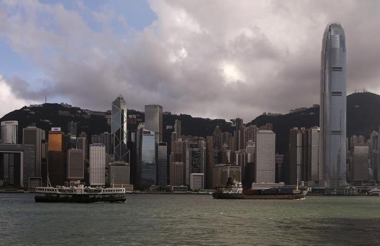 A Star Ferry sails past Hong Kong's business Central district June 18, 2014. REUTERS/Bobby Yip