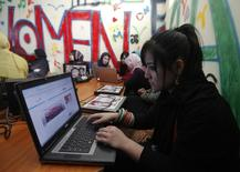Afghan girls work at a first Internet cafe for women in Kabul March 8, 2012. REUTERS/Mohammad Ismail