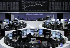 Traders are pictured at their desks in front of the DAX board at the Frankfurt stock exchange November 5, 2014.     REUTERS/Remote