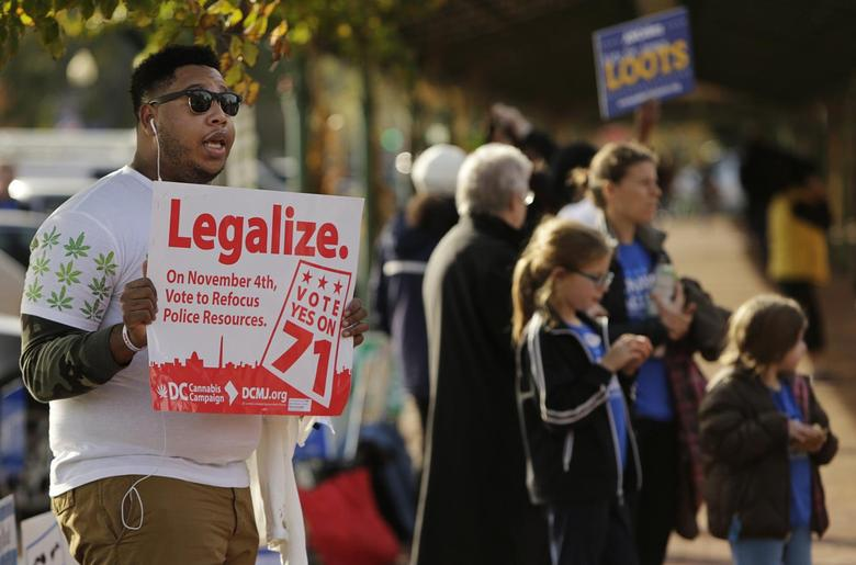 A sign urging voters to legalize marijuana, at the Eastern Market polling station in Washington, November 4, 2014.  REUTERS/Gary Cameron