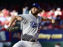 Oct 7, 2014; St. Louis, MO, USA; Los Angeles Dodgers starting pitcher Clayton Kershaw throws a pitch against the St. Louis Cardinals in the first inning during game four of the 2014 NLDS baseball playoff game at Busch Stadium. Mandatory Credit: Scott Rovak-USA TODAY Sports