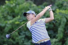 Aug 17, 2014; Pittsford, NY, USA; Lydia Ko hits her tee shot on the 3nd hole during the final round of the Wegman's Championship golf tournament at Monroe Golf Club. Mark Konezny-USA TODAY Sports