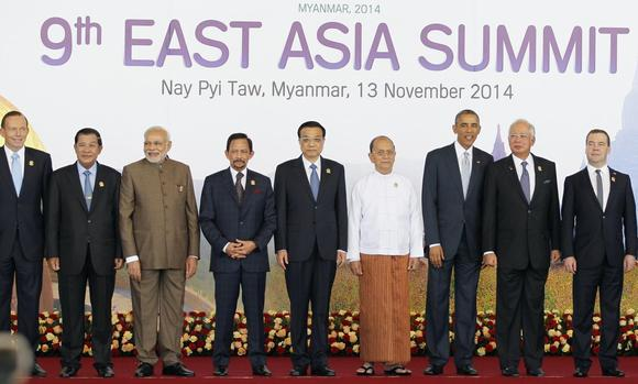 (L-R) Australian Prime Minister Tony Abbott, Cambodian Prime Minister Hun Sen, Indian Prime Minister Narendra Modi, Brunei's Sultan Hassanal Bolkiah, China's Premier Li Keqiang, Myanmar's President Thein Sein, U.S. President Barack Obama, Malaysia's Prime Minister Najib Razak and Russia's Prime Minister Dmitry Medvedev pose for a photo before the East Asia Summit (EAS) plenary session during the ASEAN Summit in Naypyitaw November 13, 2014. REUTERS/Soe Zeya Tun
