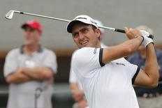 Edoardo Molinari of Italy watches his tee shot on the 13th hole during the first round of the PGA Championship at Valhalla Golf Club in Louisville, Kentucky, August 7, 2014. REUTERS/John Sommers II