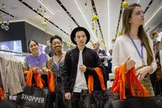 Employees wait to greet shoppers during British clothing retailer Topshop's grand opening of the chain's New York flagship store, November 5, 2014. REUTERS/Brendan McDermid