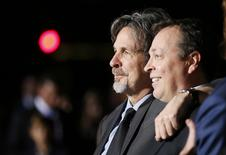"Directors, writers and producers Peter Farrelly (L) and Bobby Farrelly pose at the world premiere of the film ""Dumb and Dumber To"" in Los Angeles, November 3, 2014.   REUTERS/Danny Moloshok"
