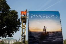 "Advertising for the new Pink Floyd album ""The Endless River"" is installed on a four sided billboard on the South Bank in London September 22, 2014.  REUTERS/Luke MacGregor"