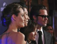 "Angelina Jolie (L-R), cast member Miyavi, his wife Melody Ishihara and Brad Pitt attend the world premiere of Jolie's film ""Unbroken"" at the State Theatre in Sydney November 17, 2014.  REUTERS/Patrick Riviere"