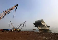 Decommissioned Indian Navy Ship INS Vikrant is pictured at a ship breaking yard in Mumbai November 17, 2014.  REUTERS/Shailesh Andrade