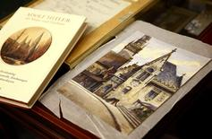 A watercolour of the old registry office in Munich by former German dictator Adolf Hitler lies next to a catalog of his paintings and drawings at Weidler auction house in Nuremberg November 18, 2014. REUTERS/Kai Pfaffenbach