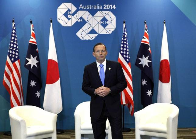 Australian Prime Minister Tony Abbott waits for Japanese Prime Minister Shinzo Abe and U.S. President Barack Obama for their meeting at the G20 in Brisbane November 16, 2014.  Reuters/KEVIN LAMARQUE