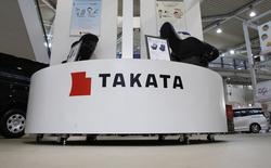 La direction américaine de la sécurité routière, la National Highway Traffic Safety Administration (NHTSA) a appelé l'équipementier automobile japonais Takata à élargir son rappel d'airbags au niveau national. Le groupe nippon est visé par une enquête pénale aux Etats-Unis en raison de ses airbags défectueux soupçonnés d'avoir joué un rôle dans la mort de cinq personnes. /Photo d'archives/REUTERS/Toru Hanai